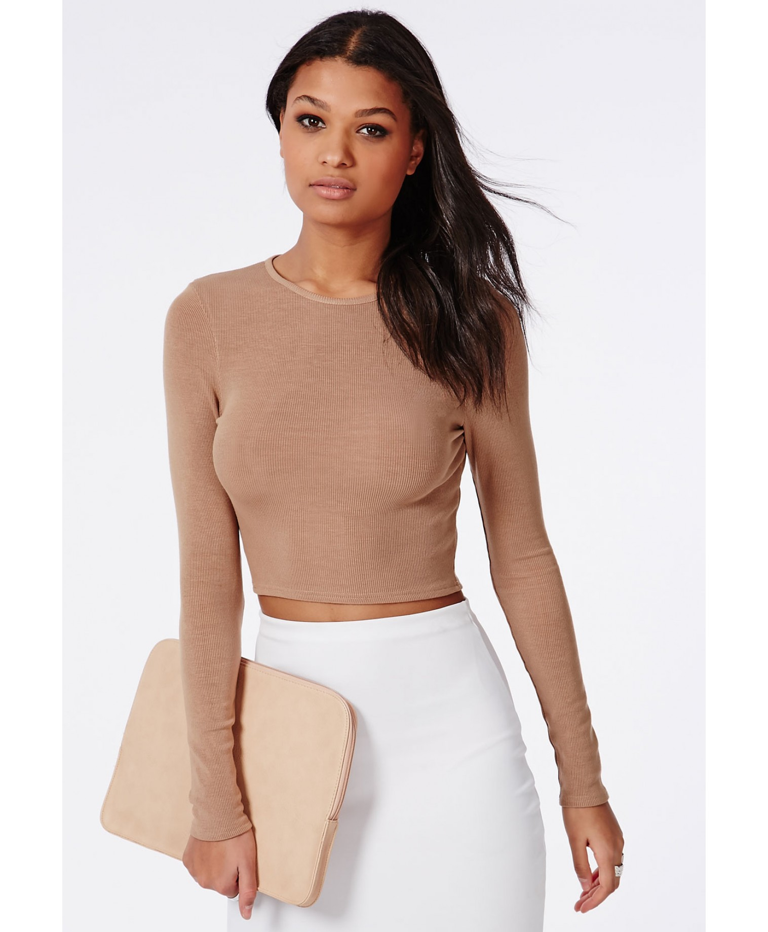 You might associate crop tops with warm weather, but that's the fun of wearing one when it's cooler—it's totally unexpected, and very sexy. Throw on one of these long sleeve ones under a.