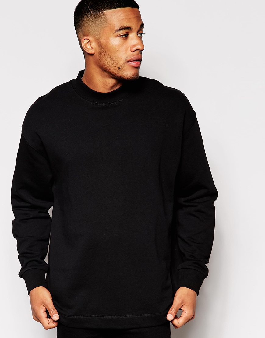 Black cotton oversized sweatshirt from UNUSED featuring a round neck, dropped shoulders, long sleeves, a chest pocket, a loose fit, a straight hem and contrast stitching trim.