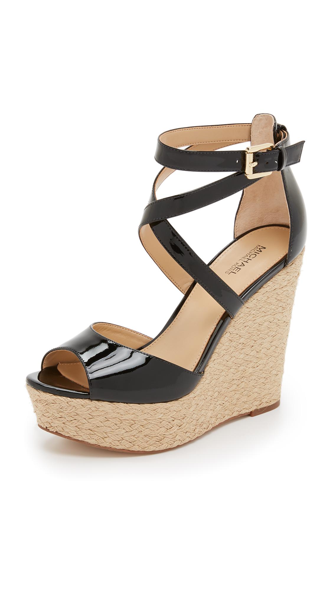 583bb8ff6ae Lyst - MICHAEL Michael Kors Gabriella Wedge Sandals in Black