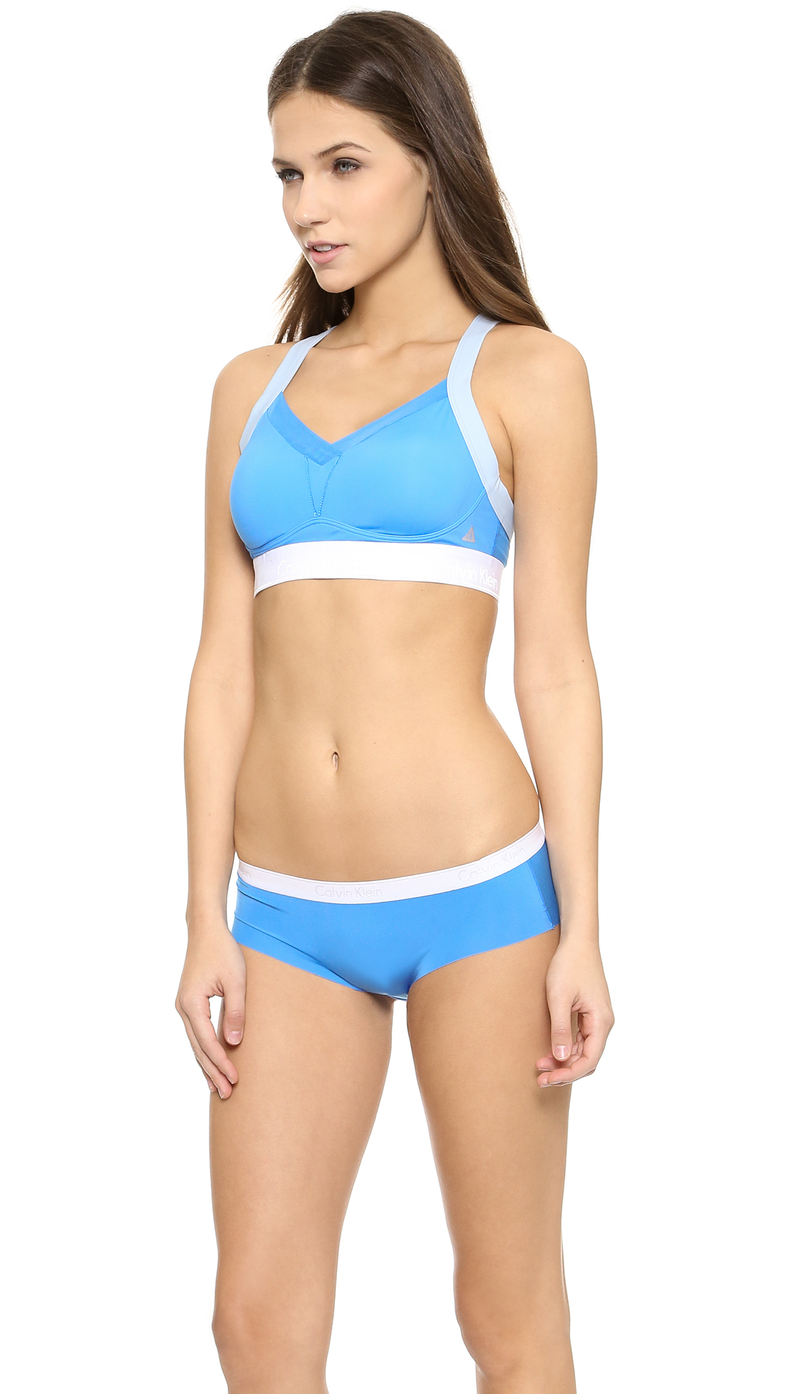 2331b8035d115 Lyst - Calvin Klein Flex Motion High Impact Bra - Aquarium Colorblock in  Blue