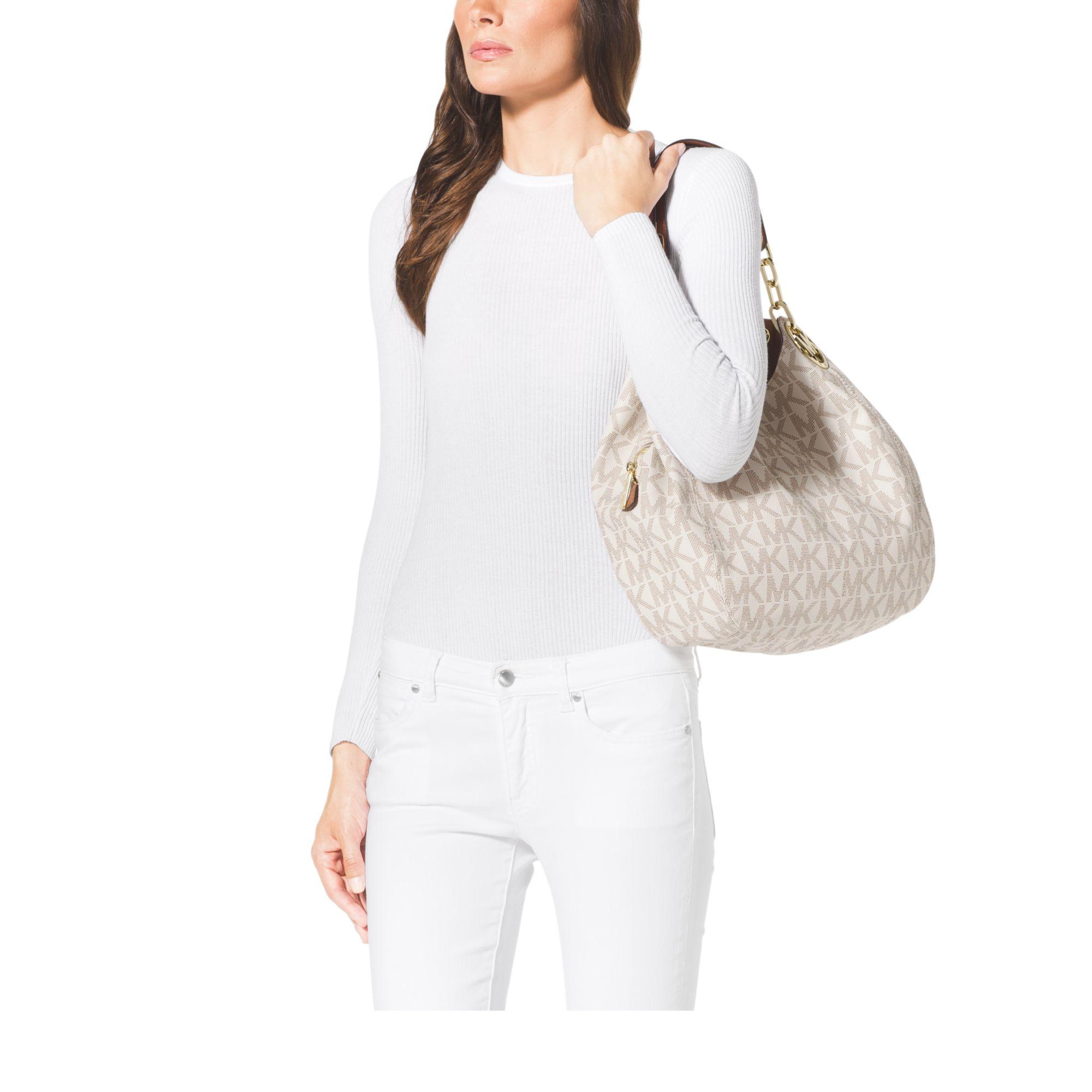d94646a38172 Lyst - Michael Kors Fulton Large Logo Shoulder Bag in White