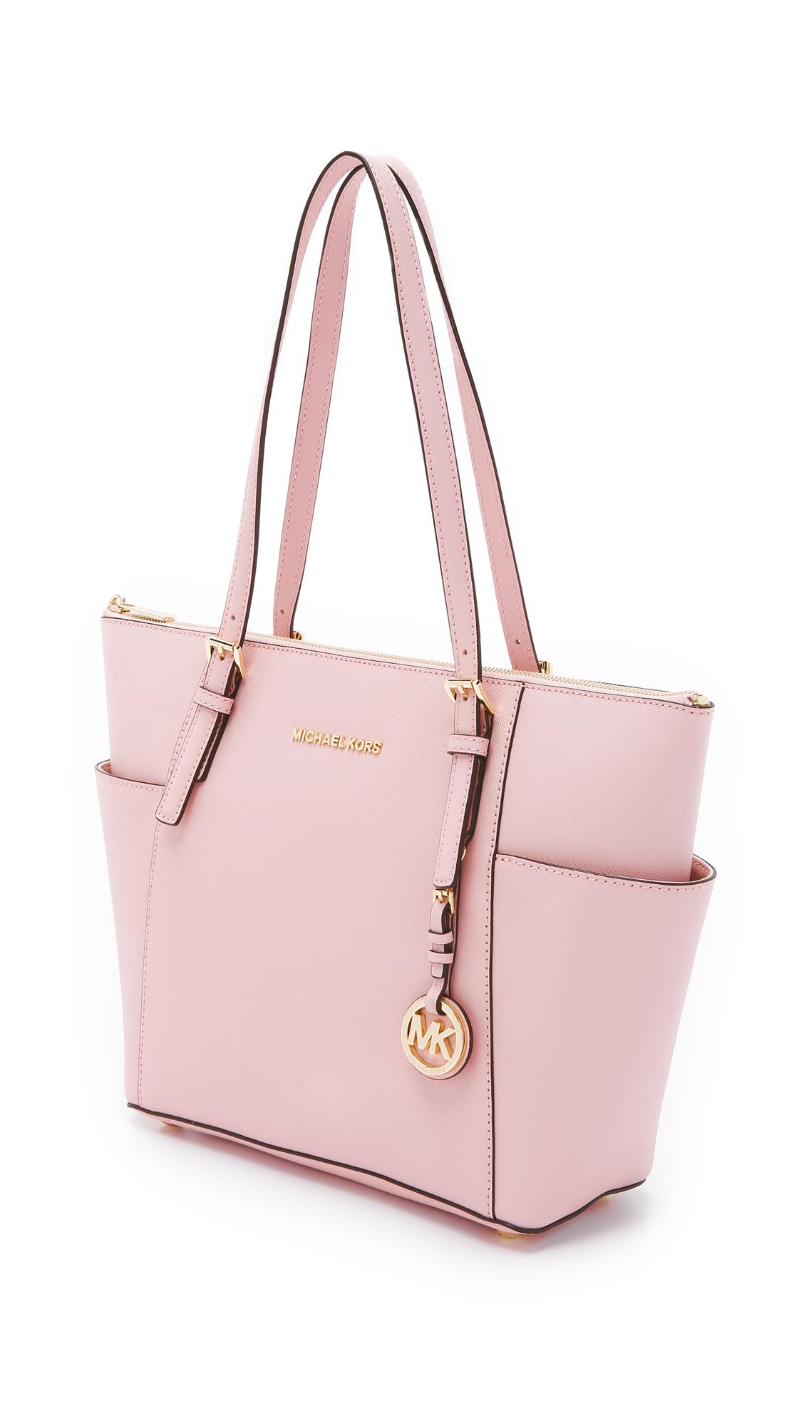 13db8f81c43c ... shop lyst michael michael kors jet set top zip saffiano tote bag in  pink 761e3 02e7e