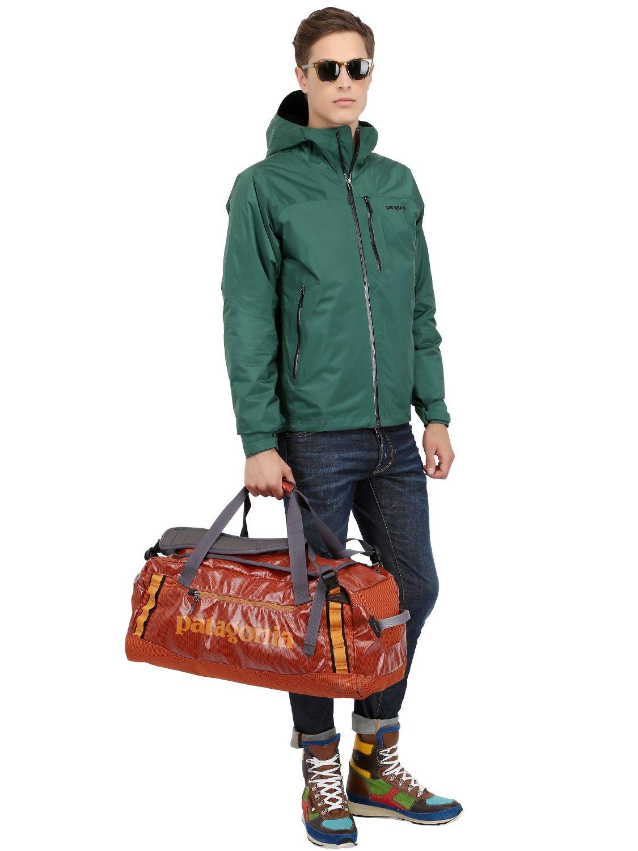 Patagonia Black Hole Duffle Bag In Orange For Men Lyst