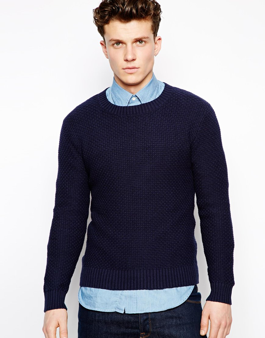 A jumper or jersey (British English), or sweater (American English) is a garment intended to cover the torso and arms. A jumper is either a pullover or a cardigan, distinguished in that cardigans open at the front while pullovers do not.