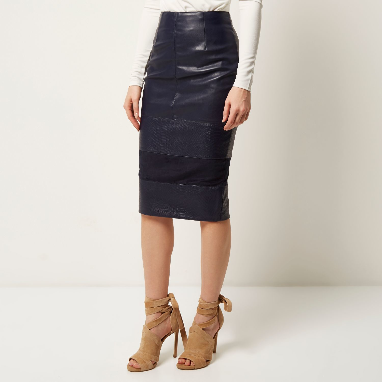 Stunning Black Leather Escada Leather skirt with Blue stitching detailing. Kick pleat in the back. Closure is a snap and button. This is out of a huge collection of clothing and jewelry that was purchased in the late s early s and never worn.