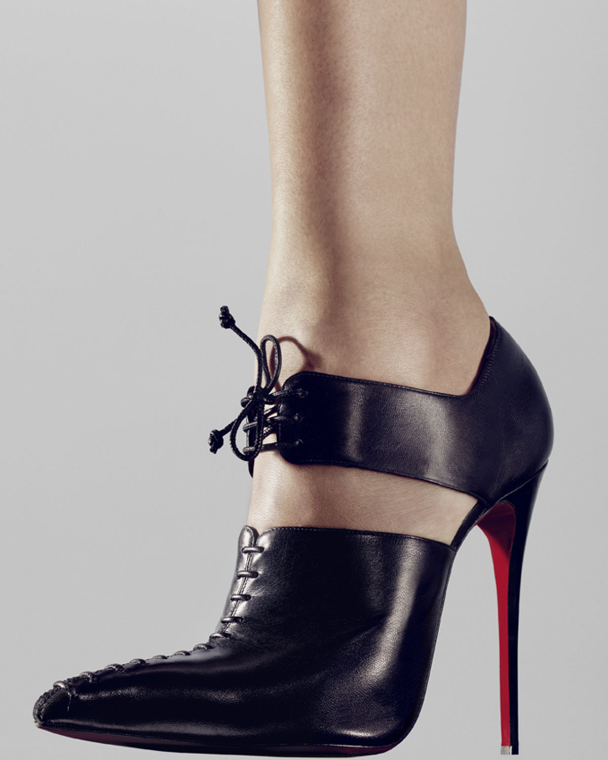 7f84c69130 Christian Louboutin Corsita Cutout Leather Red Sole Ankle Boot in Black -  Lyst