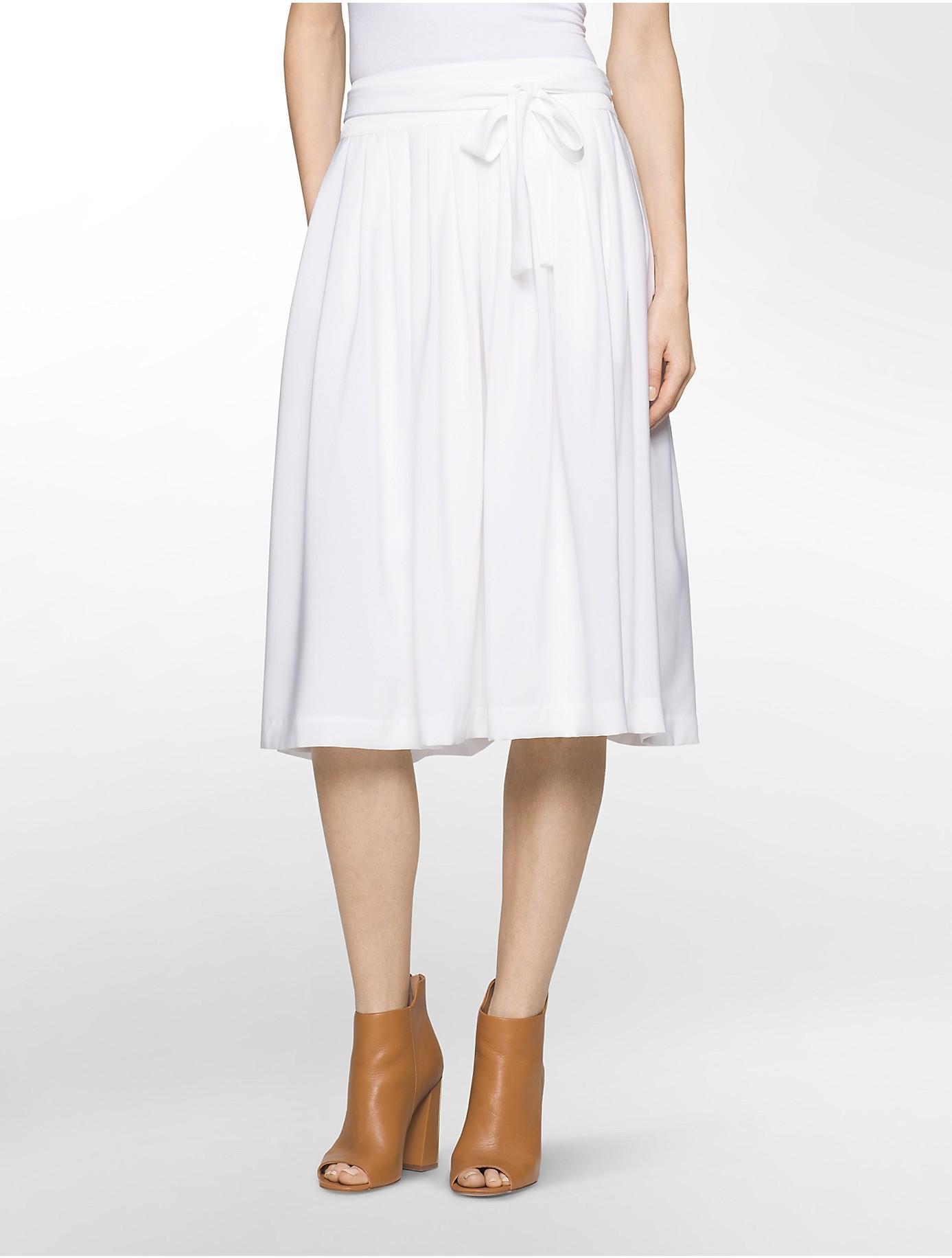 calvin klein pleated midi length belted skirt in white lyst