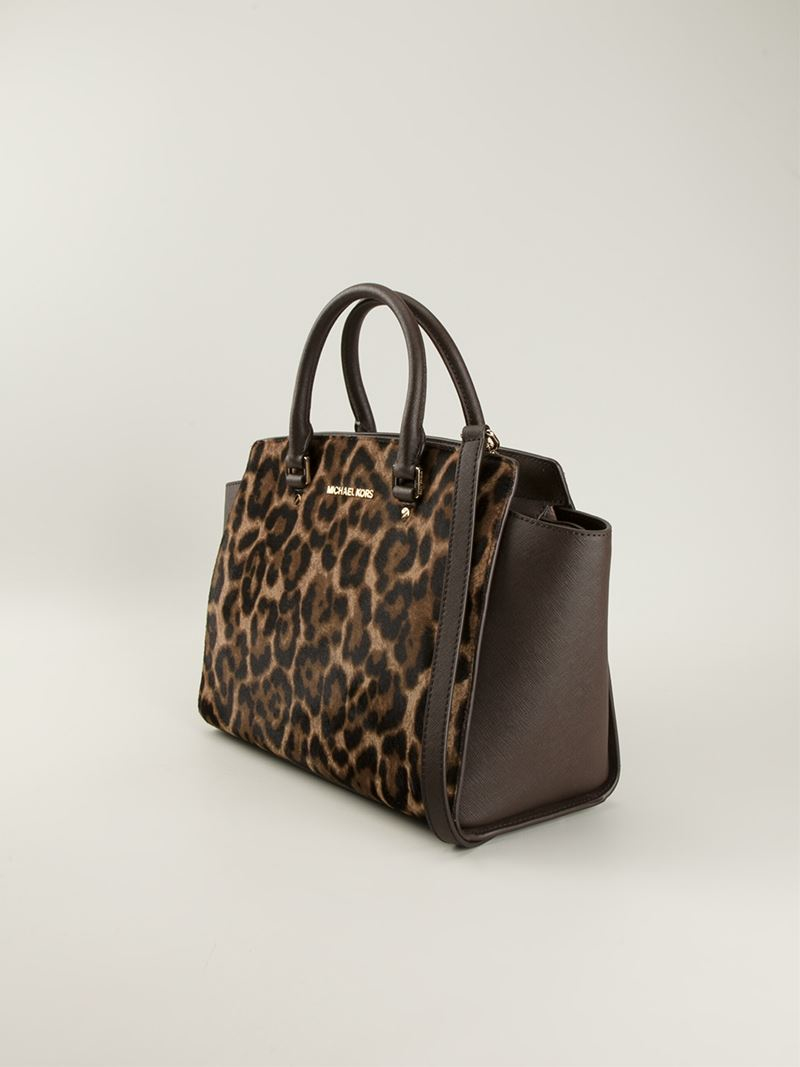b9ca43e7be56 ... reduced lyst michael michael kors selma leopard print tote in brown  8dfca b246a