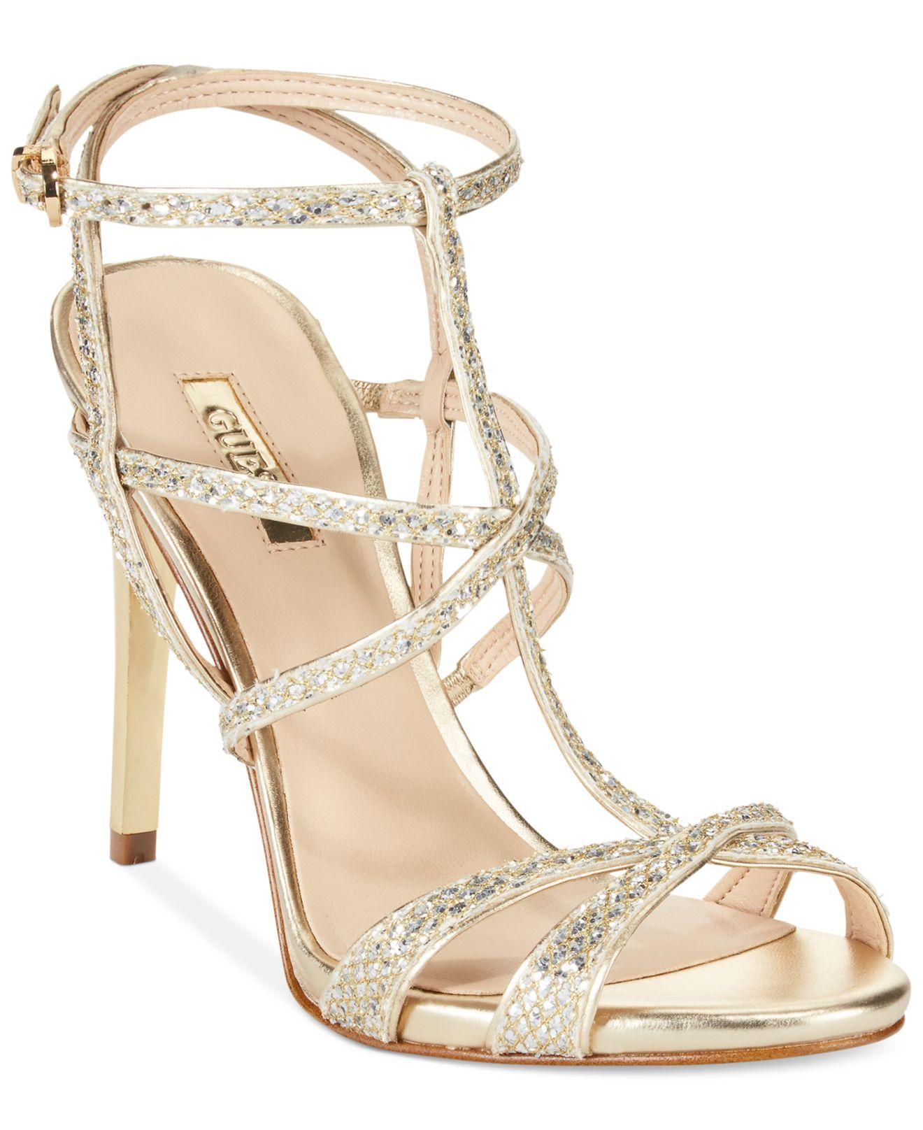 0673550a520175 Lyst - Guess Women s Carnneya Strappy T-strap Dress Sandals in Metallic