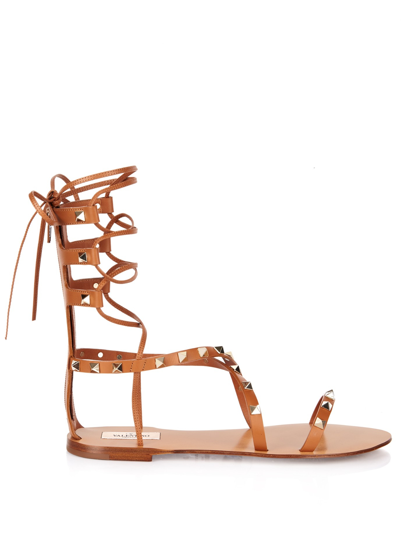 90c7ca7a8827 Lyst - Valentino Rockstud Leather Gladiator Sandals in Brown