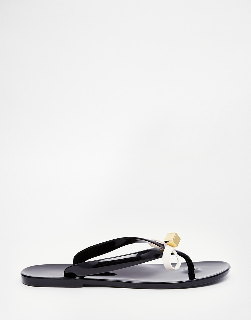 42640eb9d Lyst - Ted Baker Taito Black Jelly Bow Flip Flops in Black