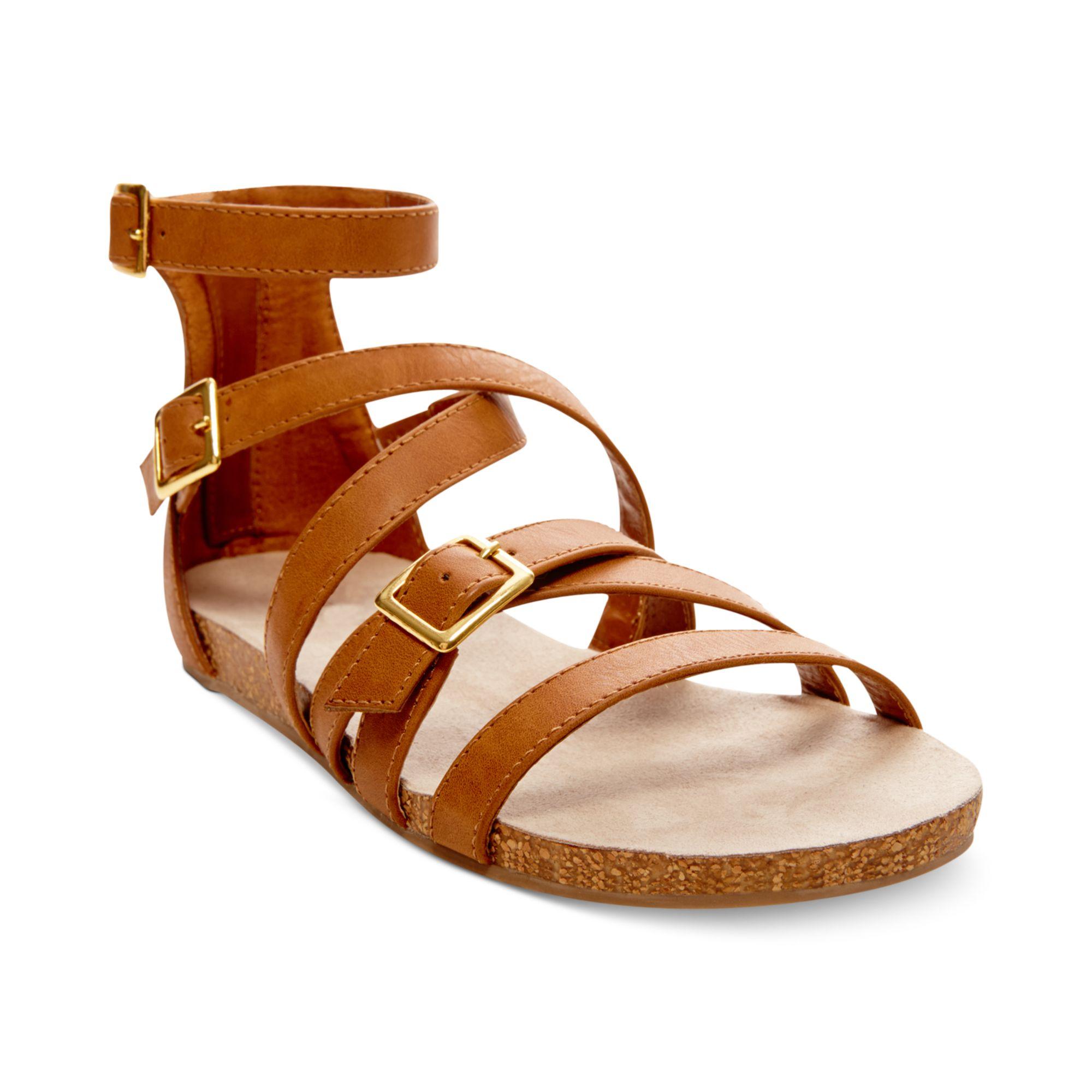7081c131126 Lyst - Madden Girl Efort Gladiator Footbed Sandals in Brown