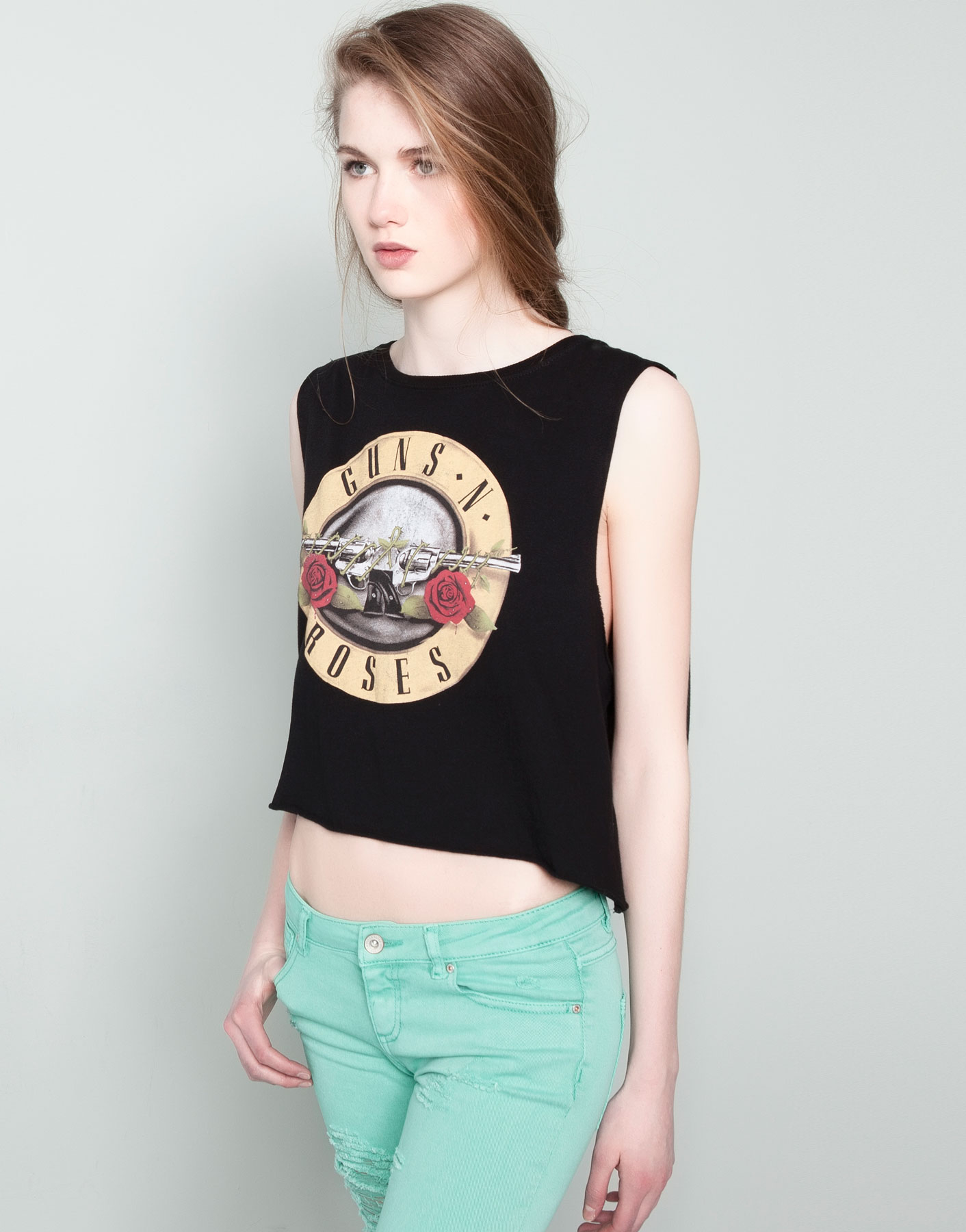 Tags Distressed band tee graphic tee Guns N' Roses studded rock n roll Gucci belt gg belt guns n roses Tops Tees - Short Sleeve Studded Guns N Roses Tee Custom Guns N Roses tee. Raw edge hems, with metal studs in multiple colors and finishes going down shoulders, and inside graphic design.