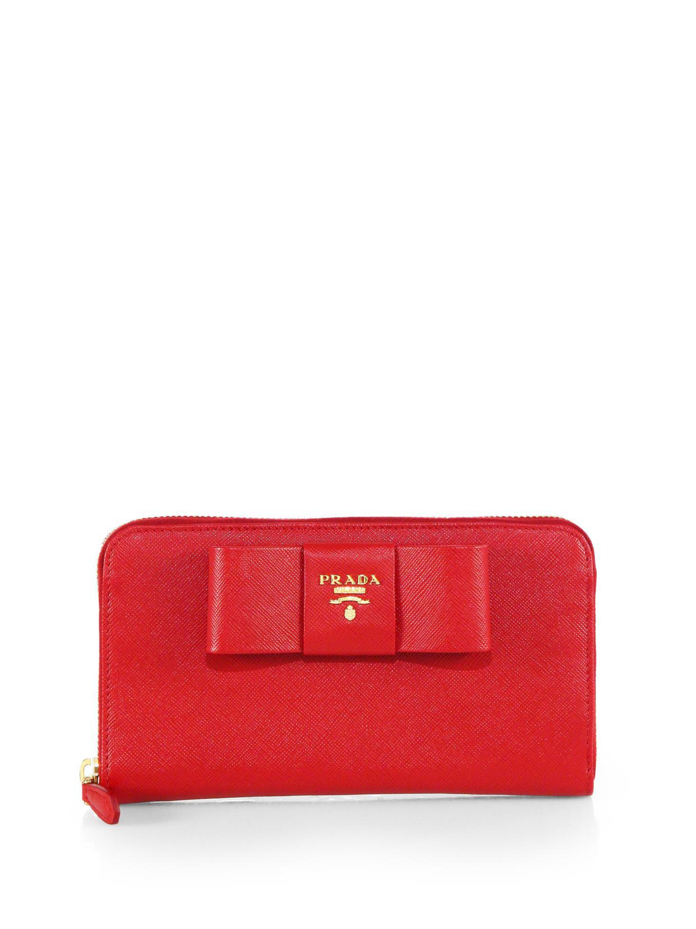 ca633d9aae3d Prada Saffiano Bow Zip-Around Wallet in Red - Lyst