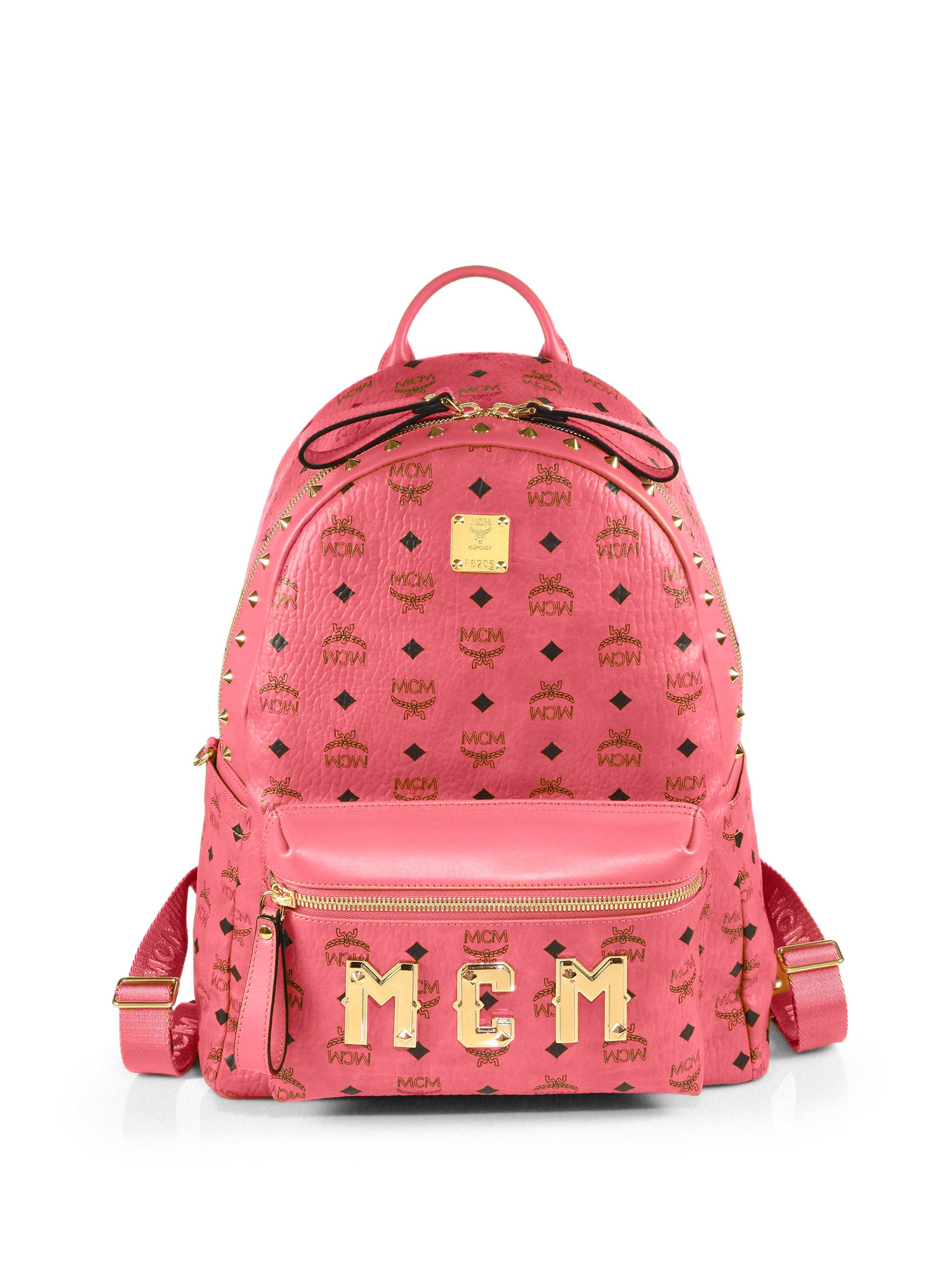 mcm visetos stark monogram backpack in red lyst. Black Bedroom Furniture Sets. Home Design Ideas