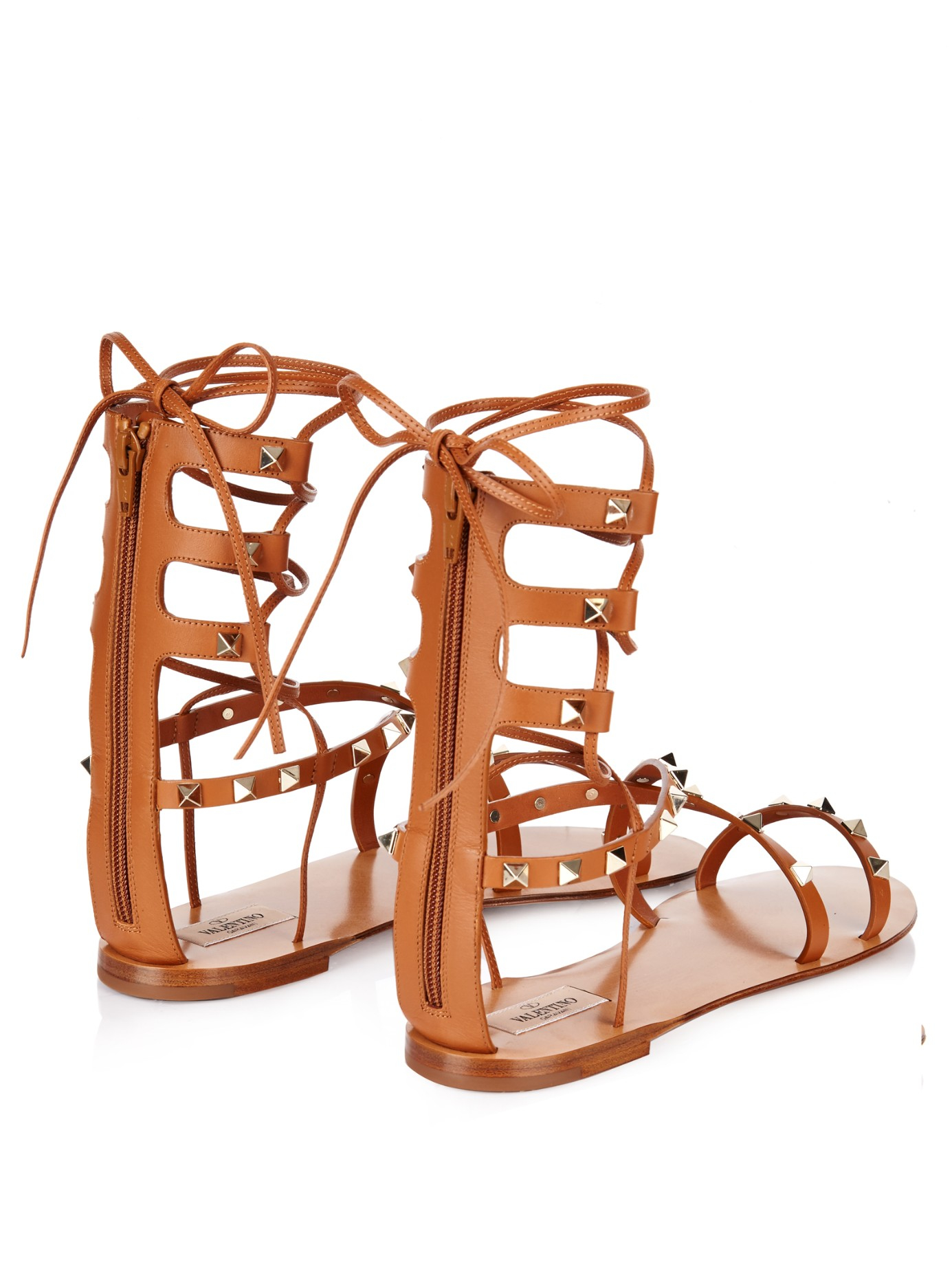 a66a7285bd3 Lyst - Valentino Rockstud Leather Gladiator Sandals in Brown