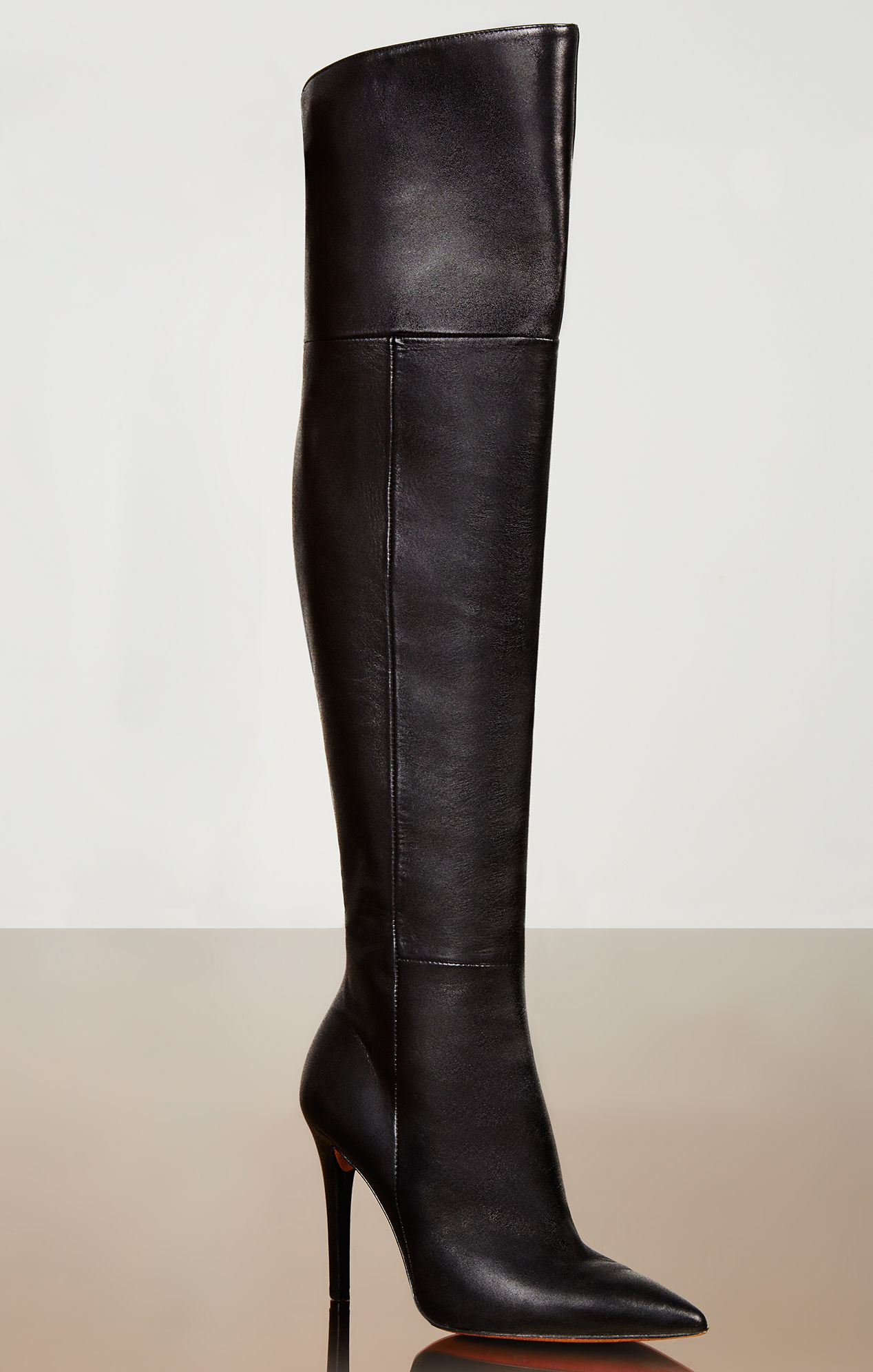 Thigh high boots from AMI Clubwear are a wardrobe staple in the closet of any fashionista. Over the years, they've evolved from a practical pair of work shoes to a high-end fashion statement, with leather thigh high boots blanketing the runways year after year.