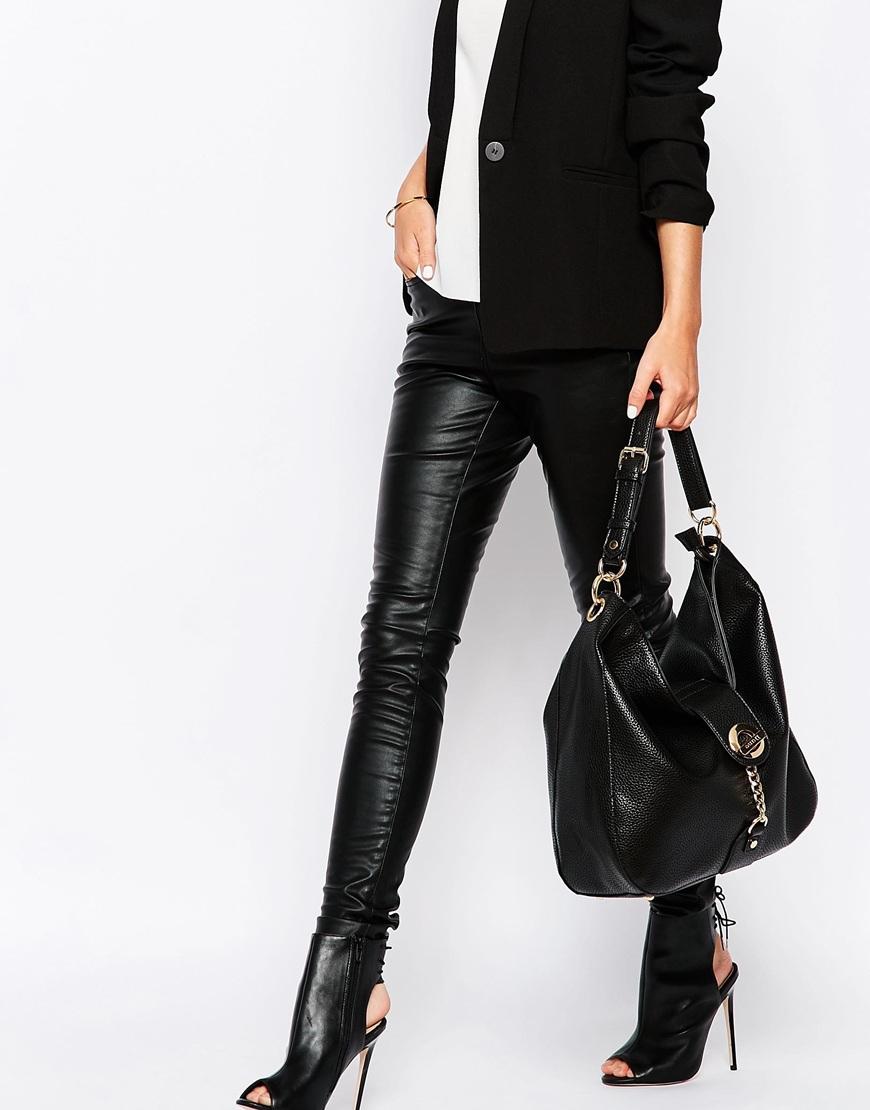 517c3dfc0d Dune Shoulder Bag With Gold Hardwear in Black