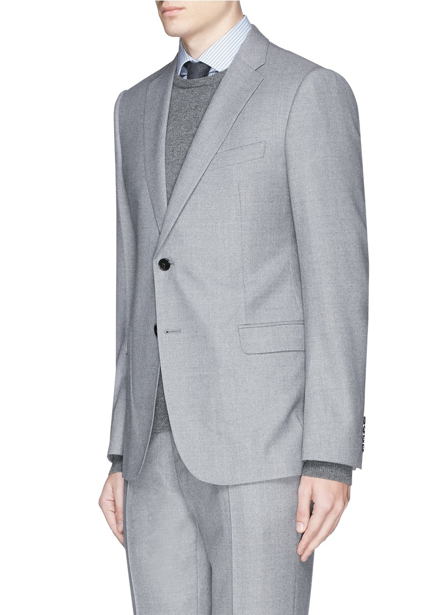 The mid-grey flannel suit is a timeless piece of menswear that is trending for autumn/winter A worthwhile investment for any modern professional, it oozes understated luxury and gentlemanly sophistication and makes a versatile and practical addition to any cold-weather tailoring collection.