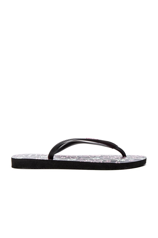 dfda182f342cb4 Lyst - Havaianas Slim Flamingo Flip-Flops in Black