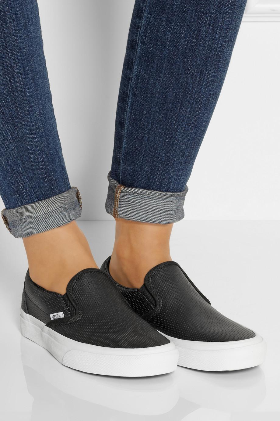 206b0ef7abf Lyst - Vans Perforated Leather Slip-On Sneakers in Black