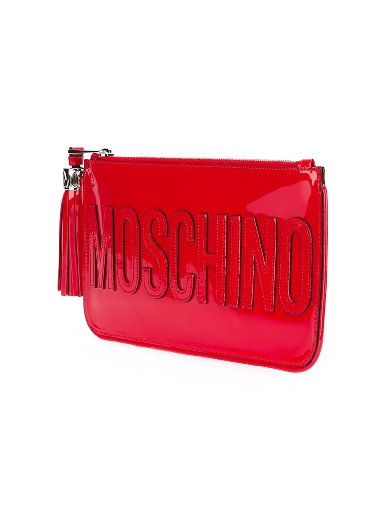 08b5096914 Moschino Stitched Logo Clutch in Red - Lyst