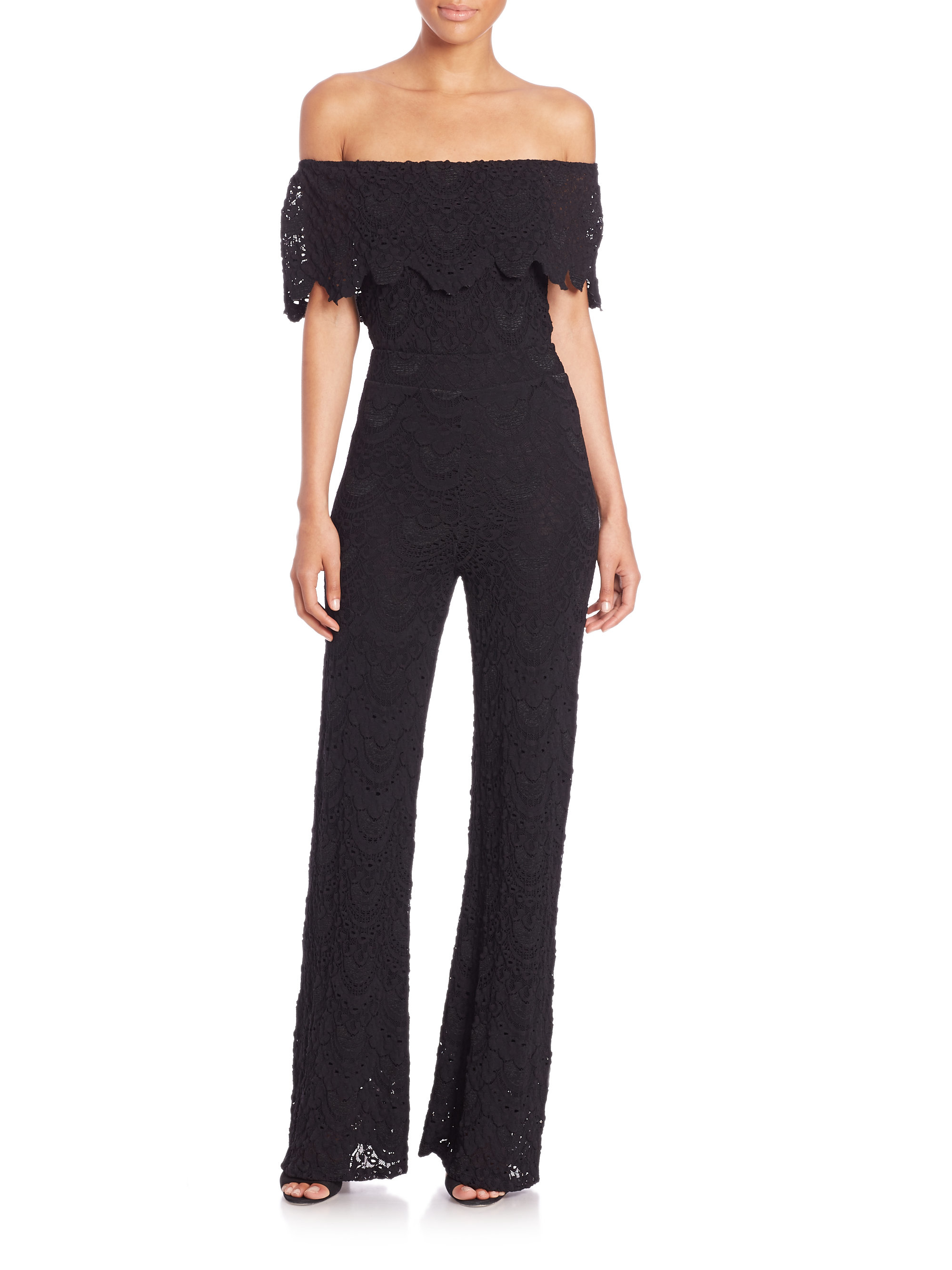 3a67a56a8447 Lyst - Nightcap Postiano Off-the-shoulder Lace Jumpsuit in Black