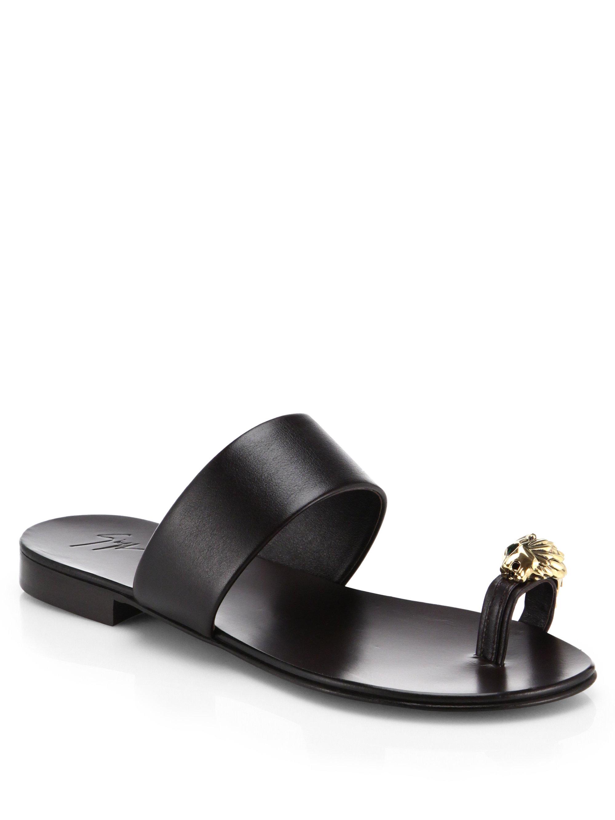 6a84982fc7775 Giuseppe Zanotti Metallic Lion Toe Ring Leather Sandals in Black - Lyst