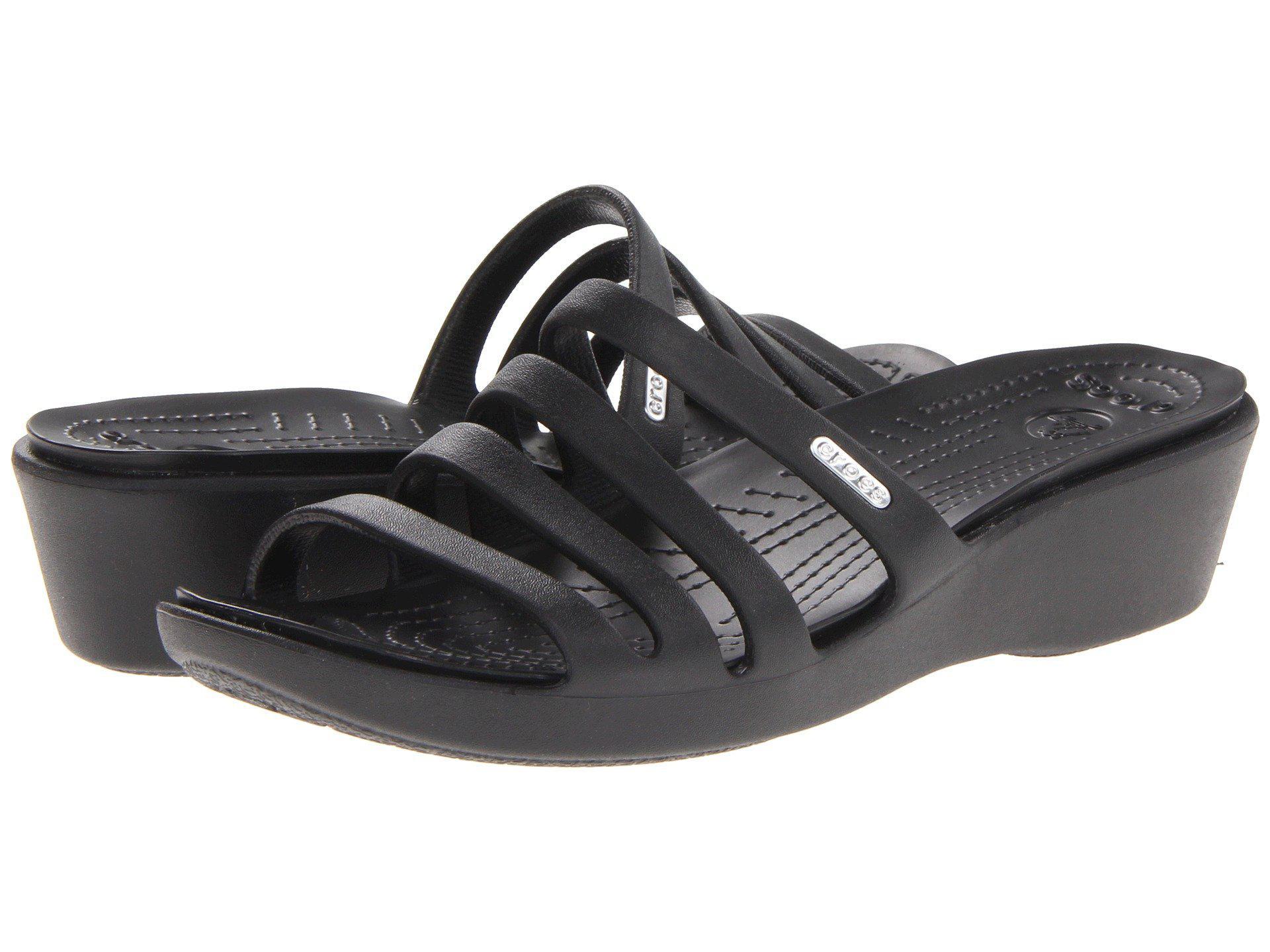 14ee4f0c142b Lyst - Crocs™ Rhonda Wedge Sandal in Black