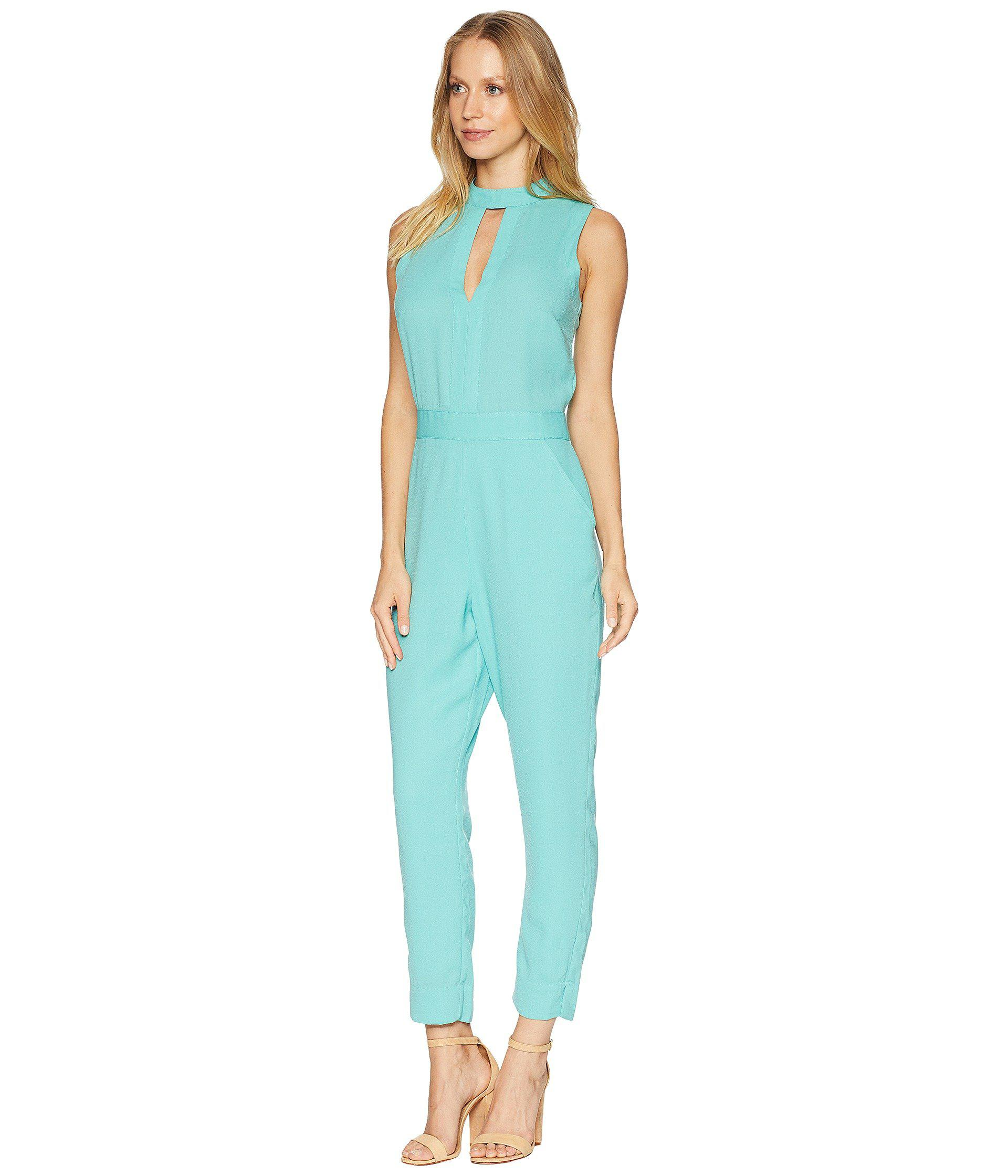 94d7ef9468bf Lyst - Bebe Keyhole Mock Tapered Leg Jumpsuit in Blue