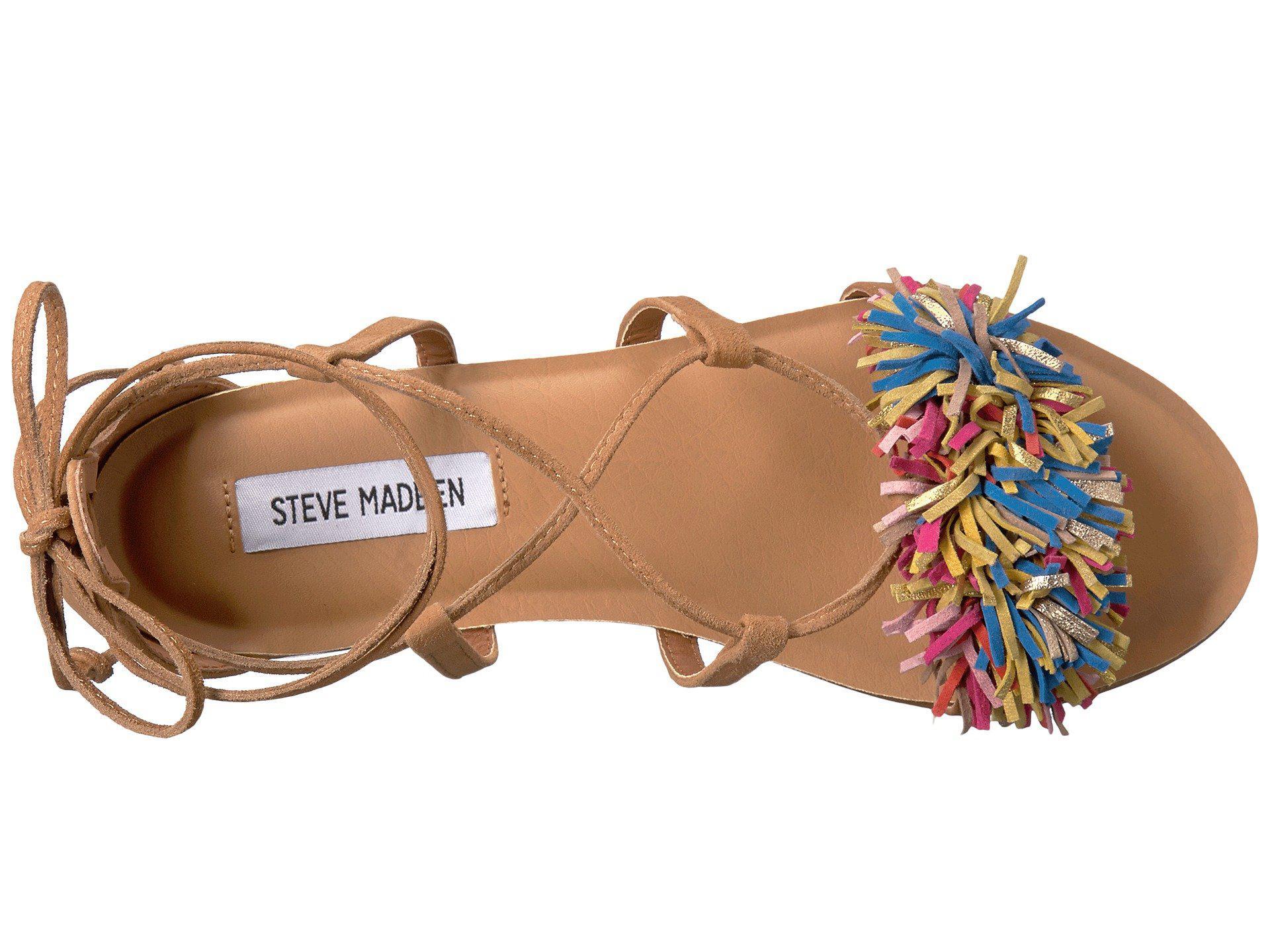 a48454e8be2b9b Lyst - Steve Madden Swizzle Tasseled Pom Pom Sandals in Brown