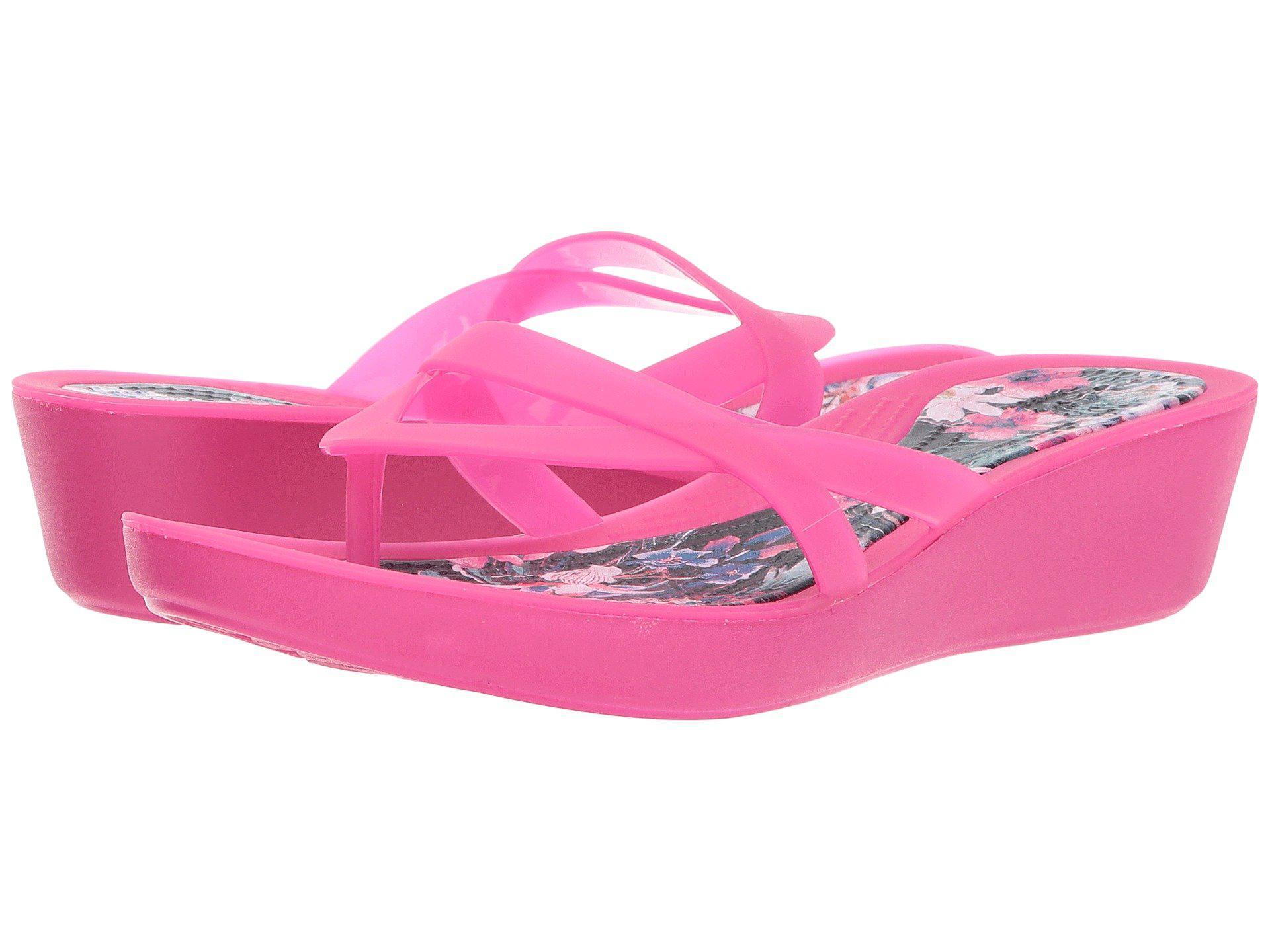 f0a37fca506 Crocstm candy pinktropical isabella print wedge flip jpg 1920x1440 Pink  croc wedges