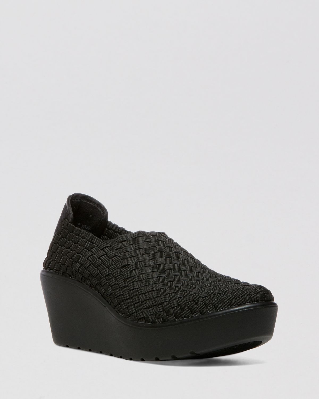 b1a5374cf3d Lyst - Steven by Steve Madden Wedge Sneakers - Betsi in Black