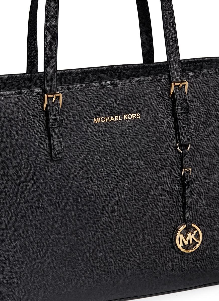 c5652959b54e closeout authentic black and gold michael kors purse 2d8b3 1bfa3; buy michael  kors jet set travel saffiano leather top zip tote in black 5c058 bd5f8