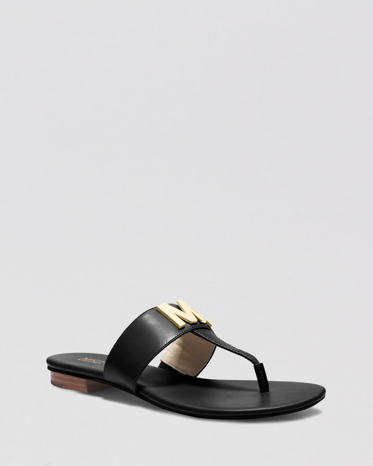 31b85685a544 Lyst - MICHAEL Michael Kors Flat Thong Sandals - Hayley Mk Logo in Black