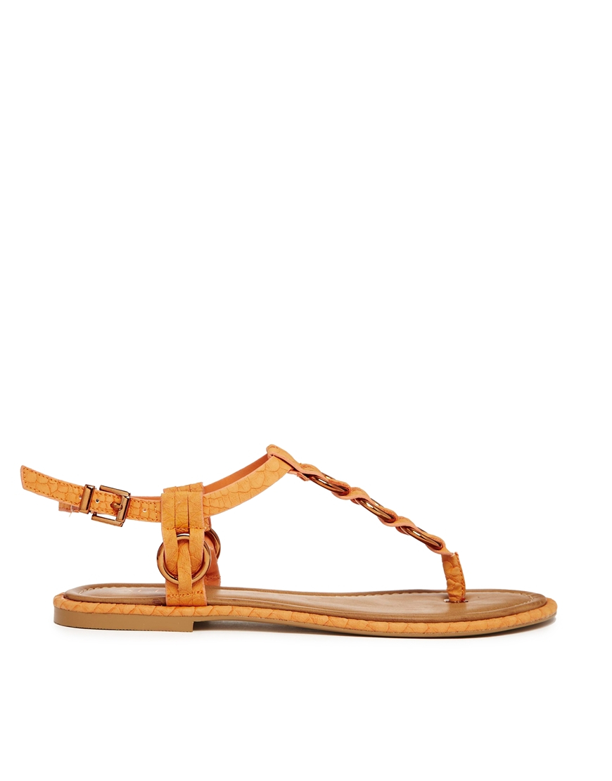 e9655e1c646b Lyst - ALDO Tbar Metal Orange Flat Sandals in Orange