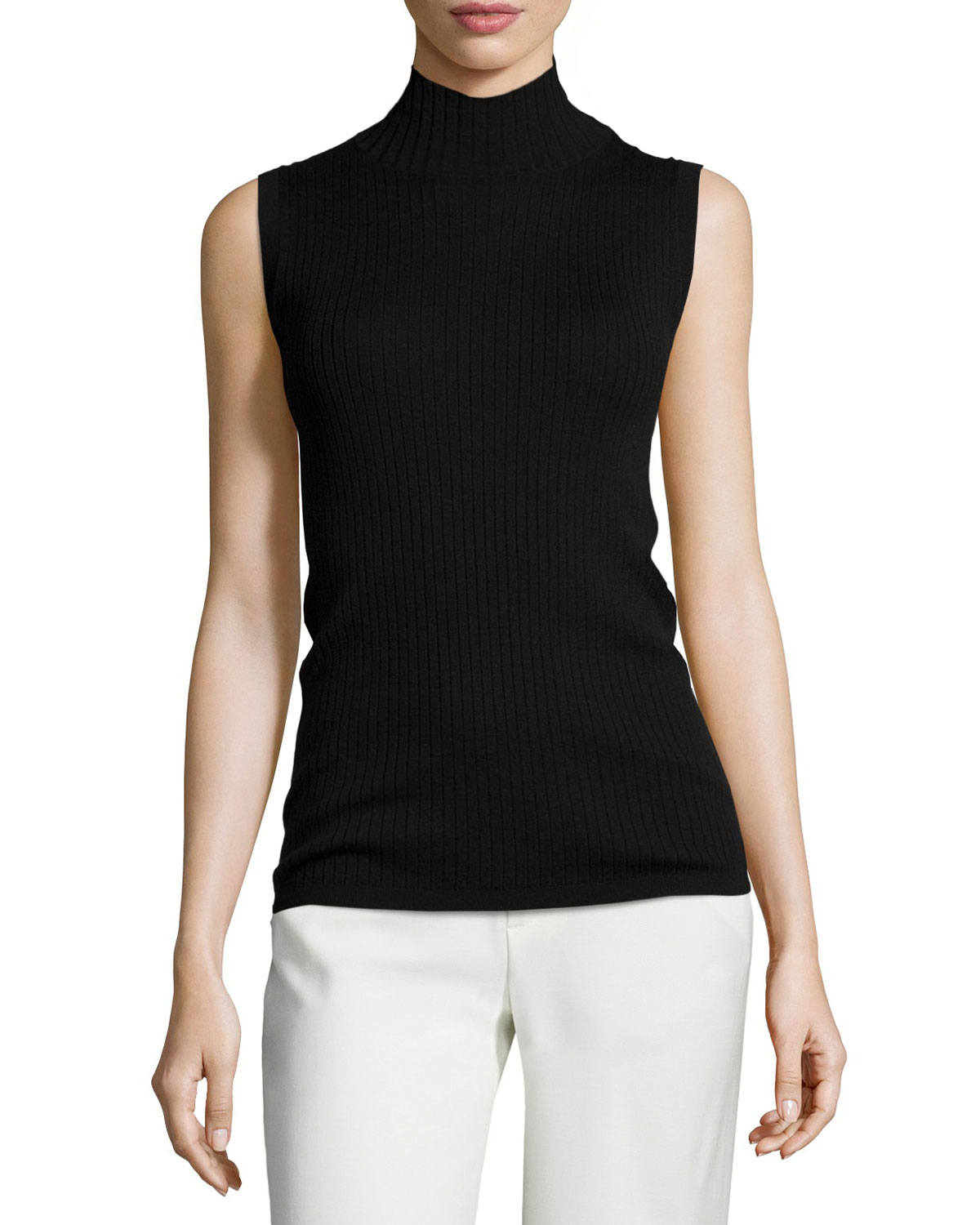 Soft black jersey knit shapes a classic turtleneck atop a cute, sleeveless bodice. This versatile top is super flattering and easy to dress up or down for a day at the office or dinner with the girls!/5().
