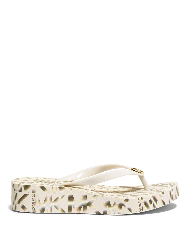 2a15f8893907af Lyst - MICHAEL Michael Kors Flip Flop Wedge Sandals - Bedford Logo ...
