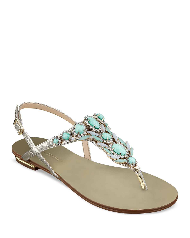 ec8ba571a7bf Lyst - Ivanka Trump Flat Thong Sandals - Jeweled in Metallic