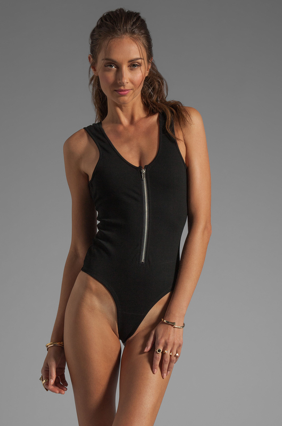 Bodysuits. Designer women's bodysuits present in a dynamic range of stylings, taking the apparel item from the street to the boudoir. Form-fitting, body-shaping utility variants flatter with a tight silhouette, showing off essential curvature while providing supreme comfort and ease of movement.