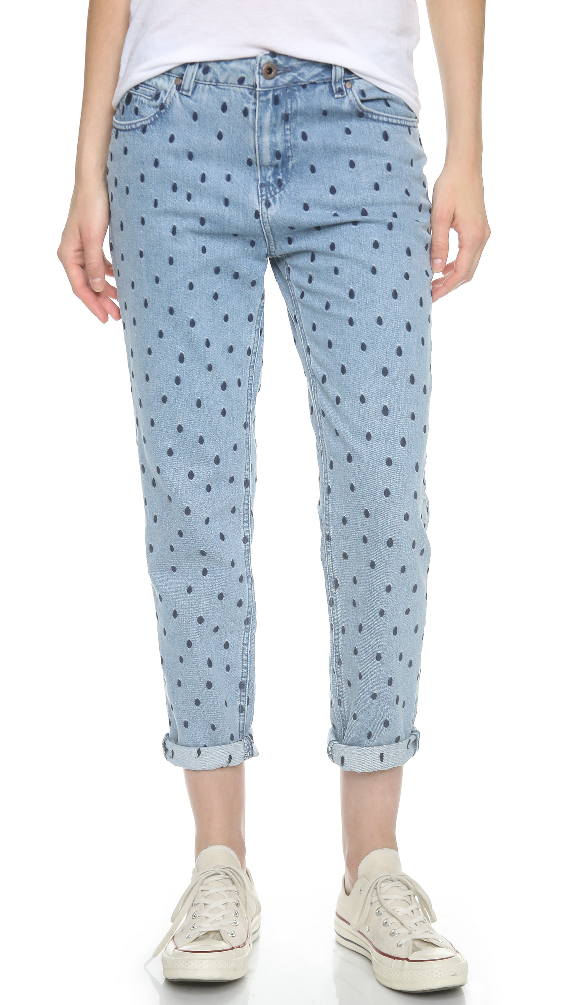 Blue jeans with a wide leg style, polka dot print and high waisted fit.