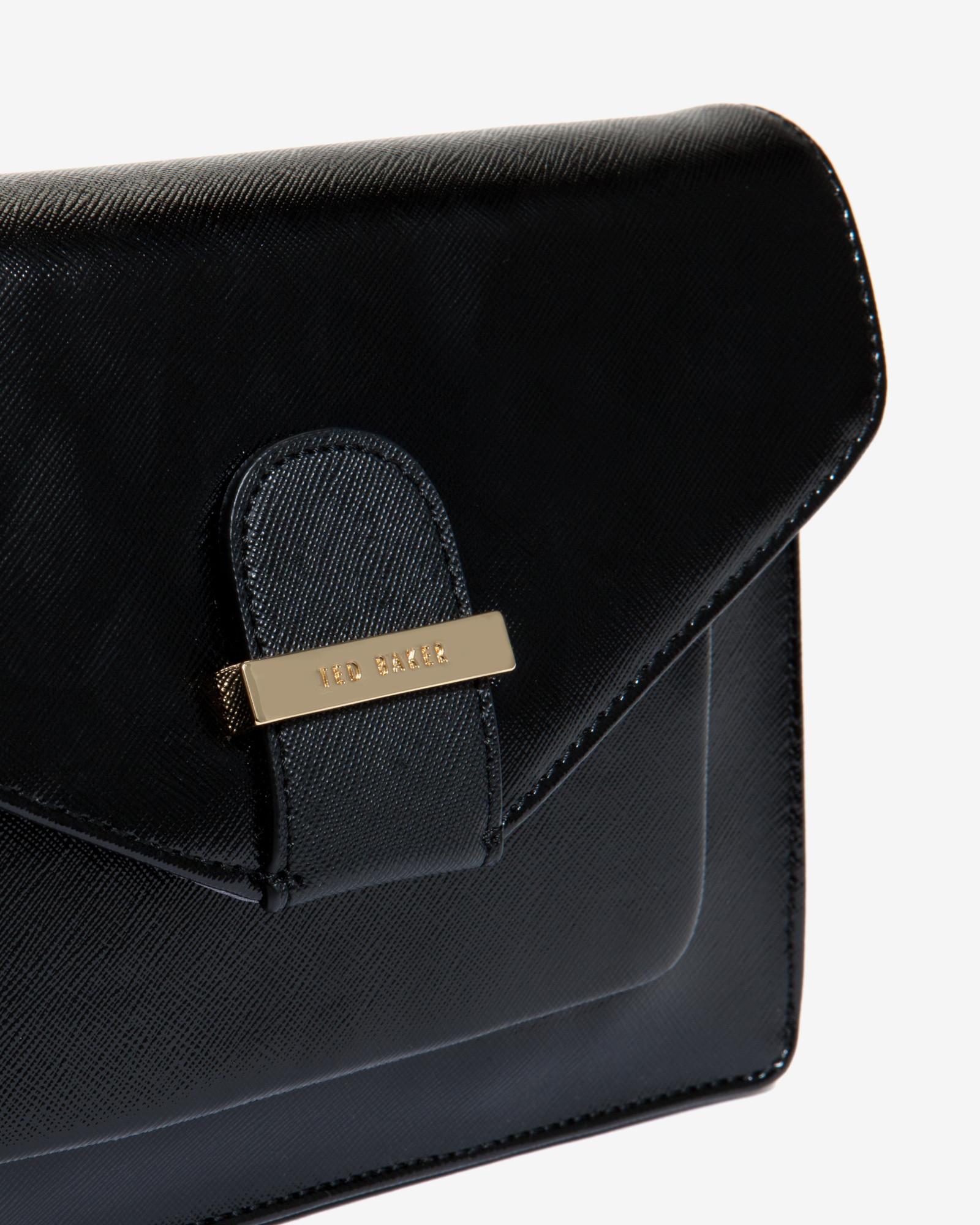 5c718719f777c Lyst - Ted Baker Patent Pocket Clutch Bag in Black