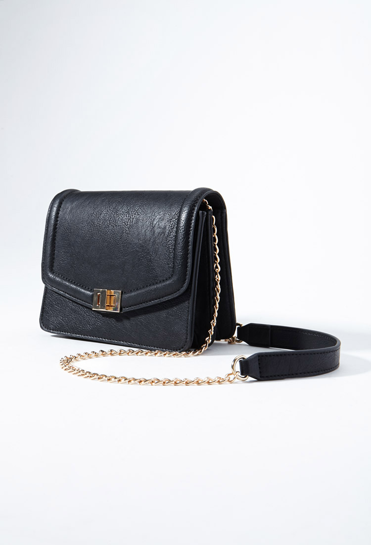 Lyst forever 21 chained faux leather crossbody in black for Faux leather what does it mean