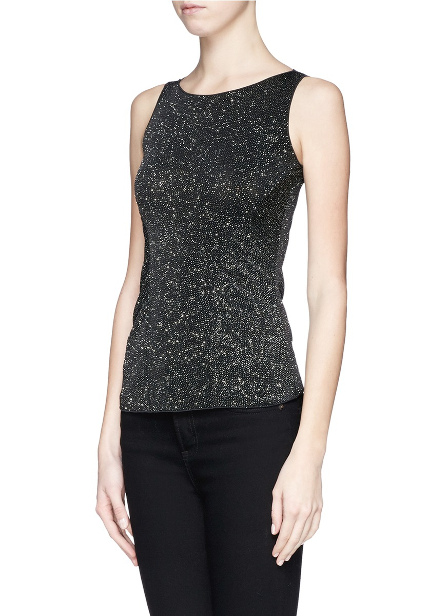 On cooler days, choose a contrasting color vest top to wear underneath. Monochrome is a classic combination, or opt for bright pink or orange under a white crop top. Belle Du Jour plus-size sequin tops come in every shade under the rainbow, and are designed to flatter curves.
