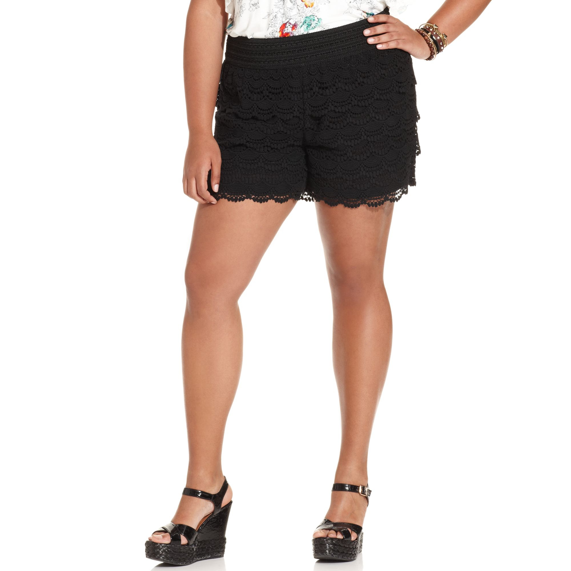 If you'd prefer a little extra length, plus size capris are a sleek and slim-fitting alternative to shorts. Black twill capris look chic with a simple, button-front top and a plus size jacket. Details like elastic waistbands and notched cuffs create a more comfortable fit.