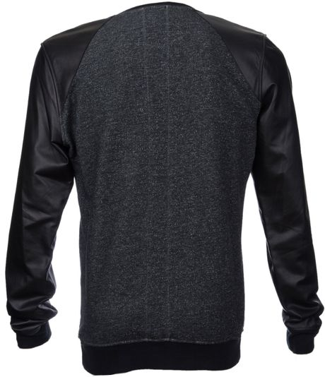 Matching your black shirt with a leather jacket is a great contrast in smart and alternative styles. It also adds a more unique finish to your look. Finish it off with some slightly faded black jeans, chunkier boots and a beanie to keep your noggin warm.