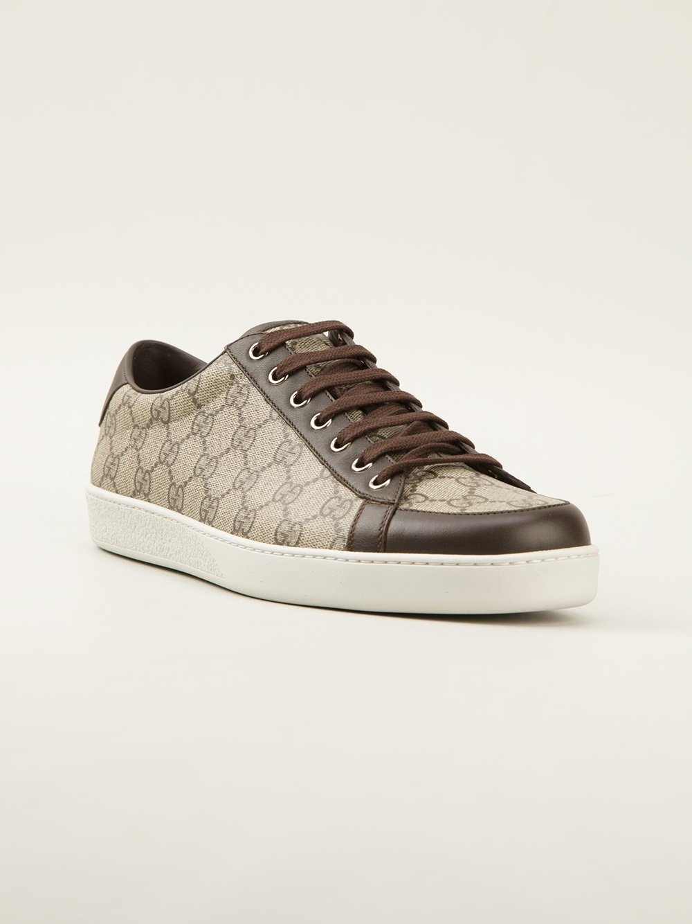 gucci monogram print trainer in brown for men