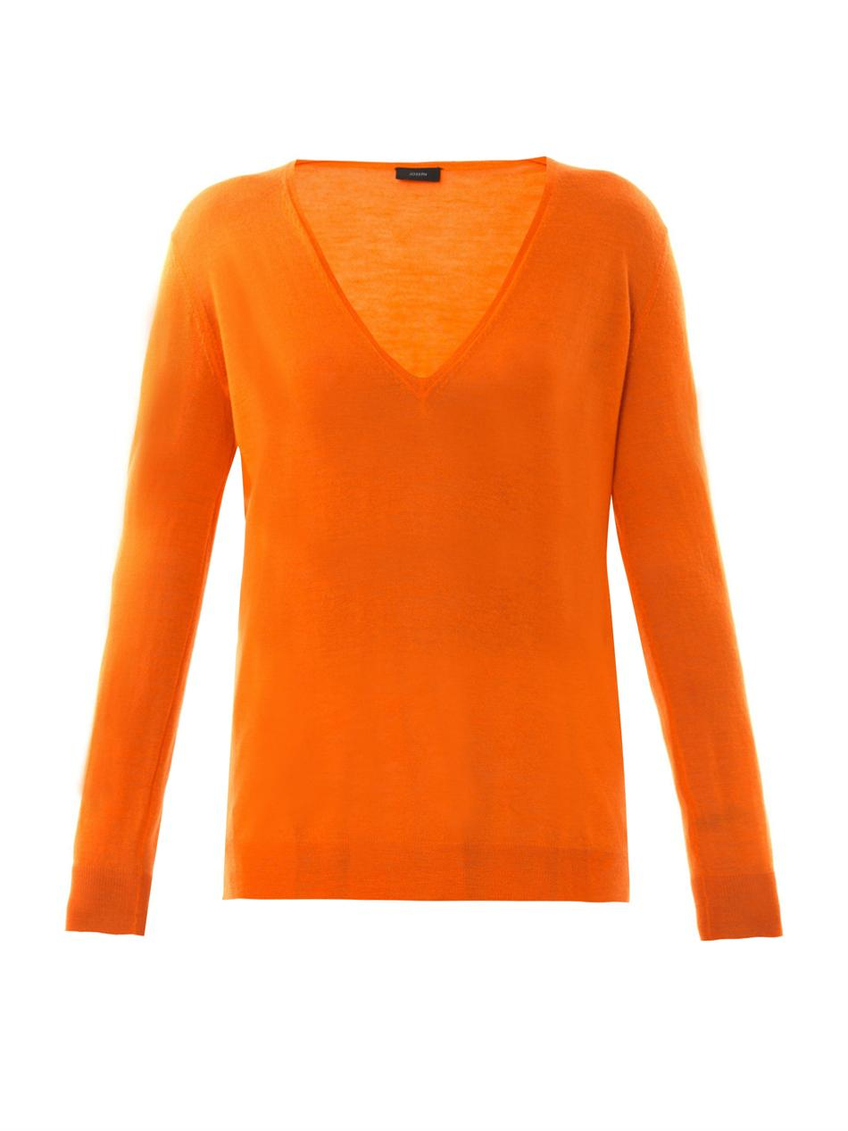 Shop Button Back Detail Sweater from VENUS to keep you warm and stylish in cooler climates.