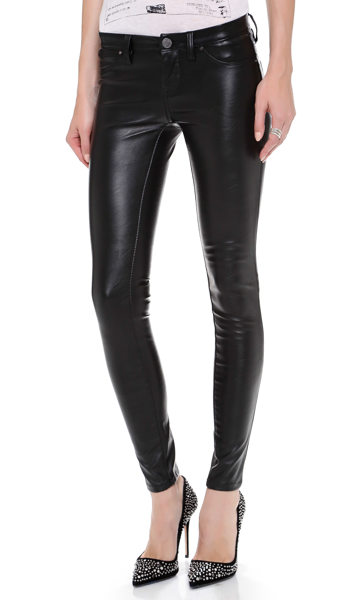 Serve up a sassy look with the LOST INK Kassidy Black Vegan Leather Pants! These sleek, vegan leather pants strike a perfect balance between chic and edgy with their skinny pant legs, high-waisted fit, and exposed silver side zipper, making them perfect for pairing with band tees, or oversized sweaters.5/5(1).