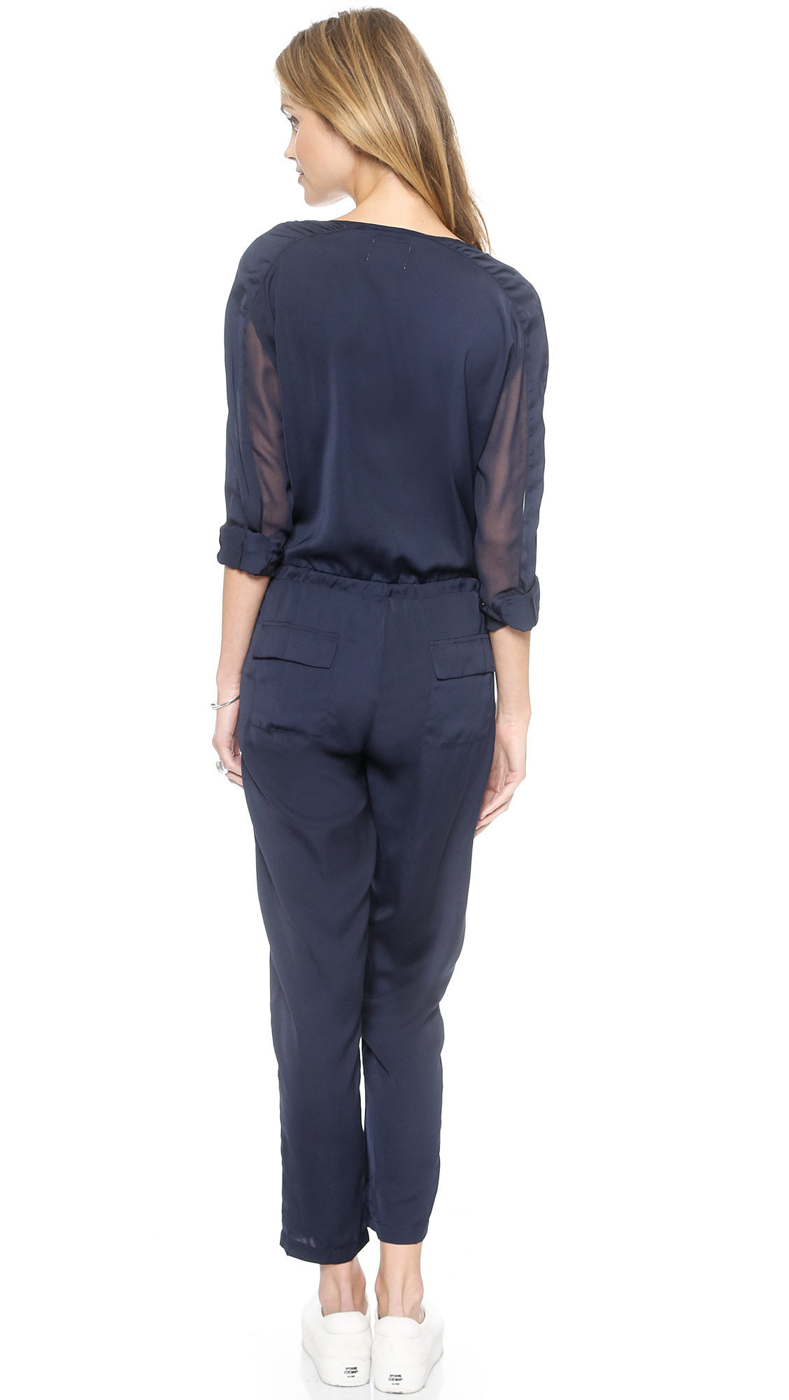 Be center of attention in this sexy jumpsuit. The features includes a bold color, one shoulder long sleeve, cut out, wrap around strap, followed by.